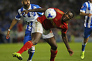 midfielder Michail Antonio of Nottingham Forest battles with Bruno Saltor of Brighton & Hove Albion during the Sky Bet Championship match between Brighton and Hove Albion and Nottingham Forest at The American Express Community Stadium, Brighton and Hove, England on 7 August 2015. Photo by Phil Duncan.