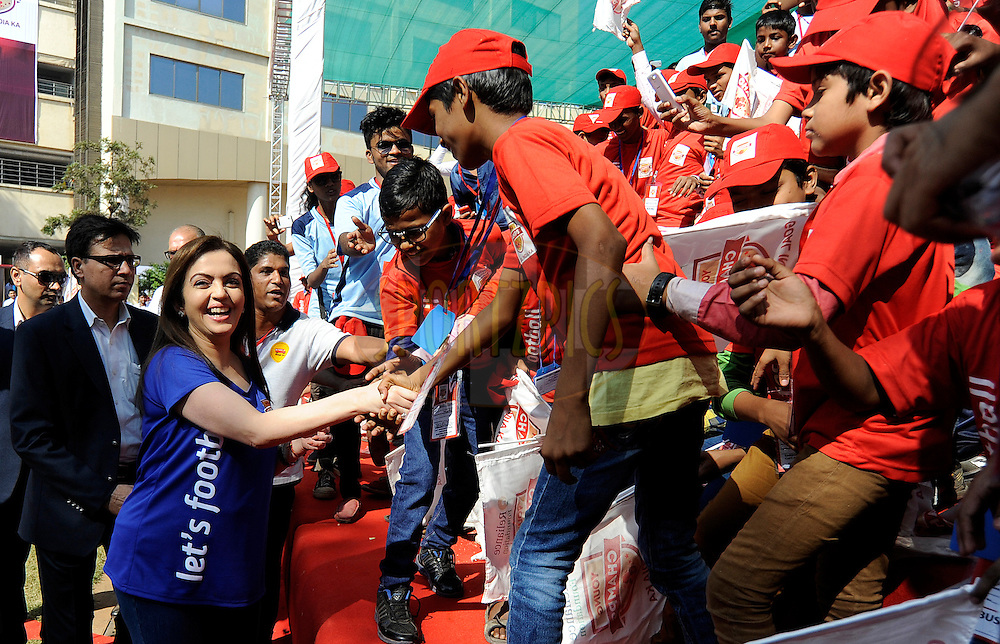 Mrs Nita Ambani meets the kids from various NGO's during the launch of the Reliance Foundation Young Champs programme held in Mumbai, India on the 7th December 2014.<br /> <br /> Photo by:  Pal Pillai/ ISL/ SPORTZPICS