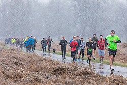 © Licensed to London News Pictures. 17/03/2018. London, UK. Runners brave further cold weather in Bushy Park as more snow falls over London. Photo credit: Rob Pinney/LNP