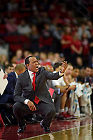 Men's basketball coach Kevin Keatts reacts to a call against the Wolfpack during ACC actino against UVA in PNC Arena.