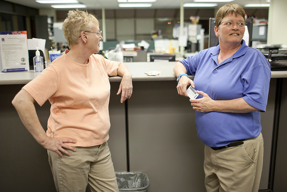 Nancy Ryherd (right) checks the time while waiting in line with her partner of seven years, Linda Schroeder, in the county clerk's office at the Macon County Office Building just after midnight Wednesday, June 1, 2011, in Decatur, Ill. The Decatur couple were first in line to apply for their civil union license. (Stephen Haas)