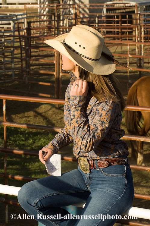 Cowgirl, bidding on bucking horses at Miles City Bucking Horse Sale, Montana
