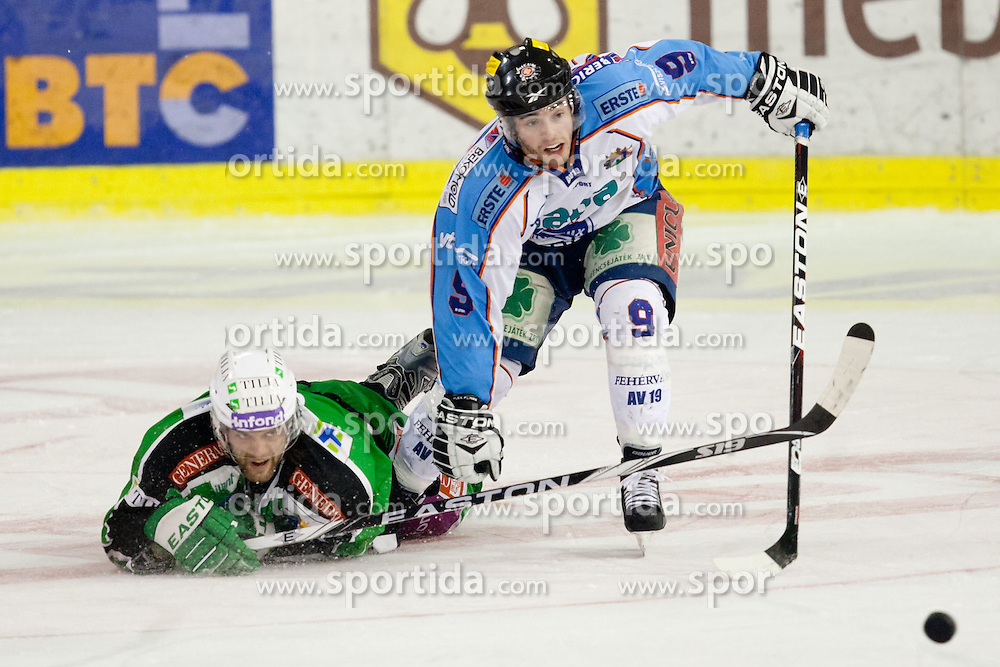 Brad Cole (HDD Tilia Olimpija, #2) and Derek Ryan (SAPA Fehervar AV19, #9) during ice-hockey match between HDD Tilia Olimpija and SAPA Fehervar AV19 at fourth match in Quarterfinal  of EBEL league, on Februar 26, 2012 at Hala Tivoli, Ljubljana, Slovenia. HDD Tilia Olimpija won 6:4. (Photo By Matic Klansek Velej / Sportida)