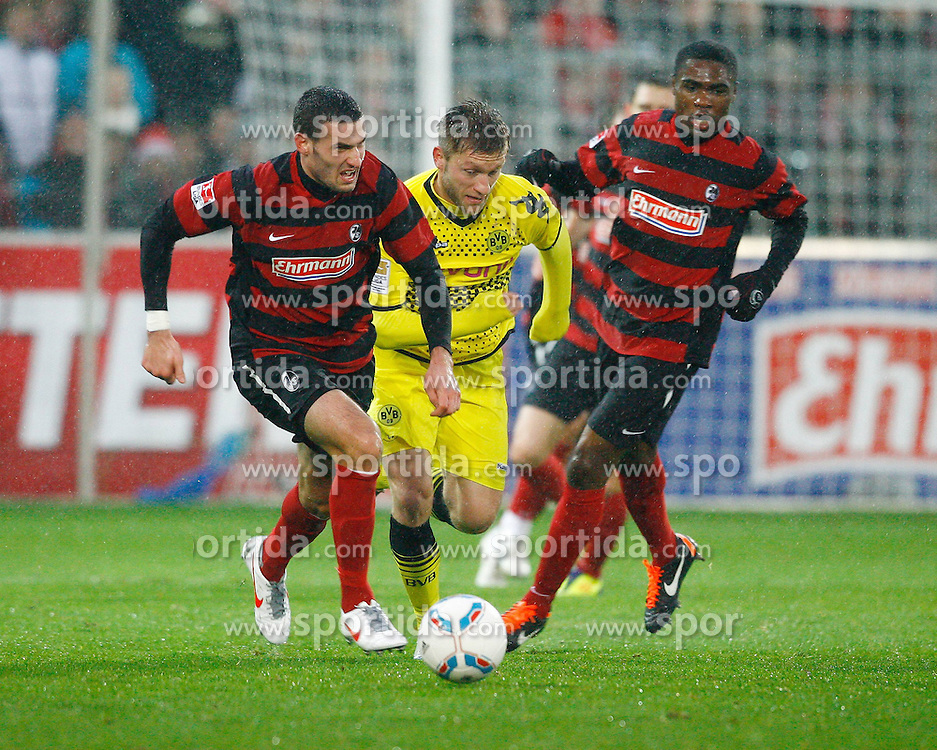 17.12.2011, Badenova Stadion, Freiburg, GER, 1.FBL, SC Freiburg vs BvB Borussia Dortmund, Daniel CALIGIURI, SCF - Jakub BLASZCYKOWSKI, KUBA, Borussia Dortmund - Cedrick MAKIADI, SCF // during the match from GER, 1.FBL, SC Freiburg vs BvB Borussia Dortmund on 2011/12/17, Badenova Stadion, Freiburg, Germany.Foto © nph/ A.Huber..***** ATTENTION - OUT OF GER, CRO *****