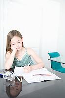Young Teeen doing her homework