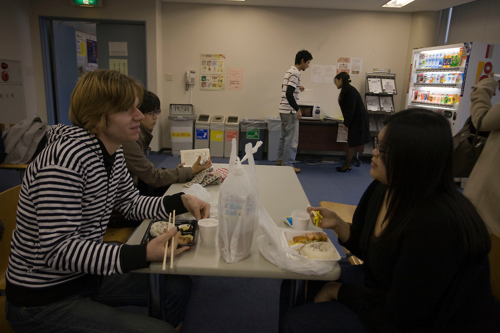 """Waseda  University Heinz Stuki 24 a Swiss Biology student and Marilyn  Manan, 22 from Brunei,  International Relations, enjoy a Typical Japanese  """"Bento"""" Lunch Box in the  Student Lounge"""