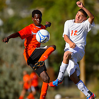 100113  Adron Gardner/Independent<br /> <br /> Gallup Bengal Tuqan Alaa (8), left,  and Grants Pirate Raul Enriquez (12) kick at the same time in Grants Tuesday.
