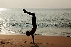 Jul. 25, 2012 - Woman practicing yoga on a beach at sunset (Credit Image: © Image Source/ZUMAPRESS.com)