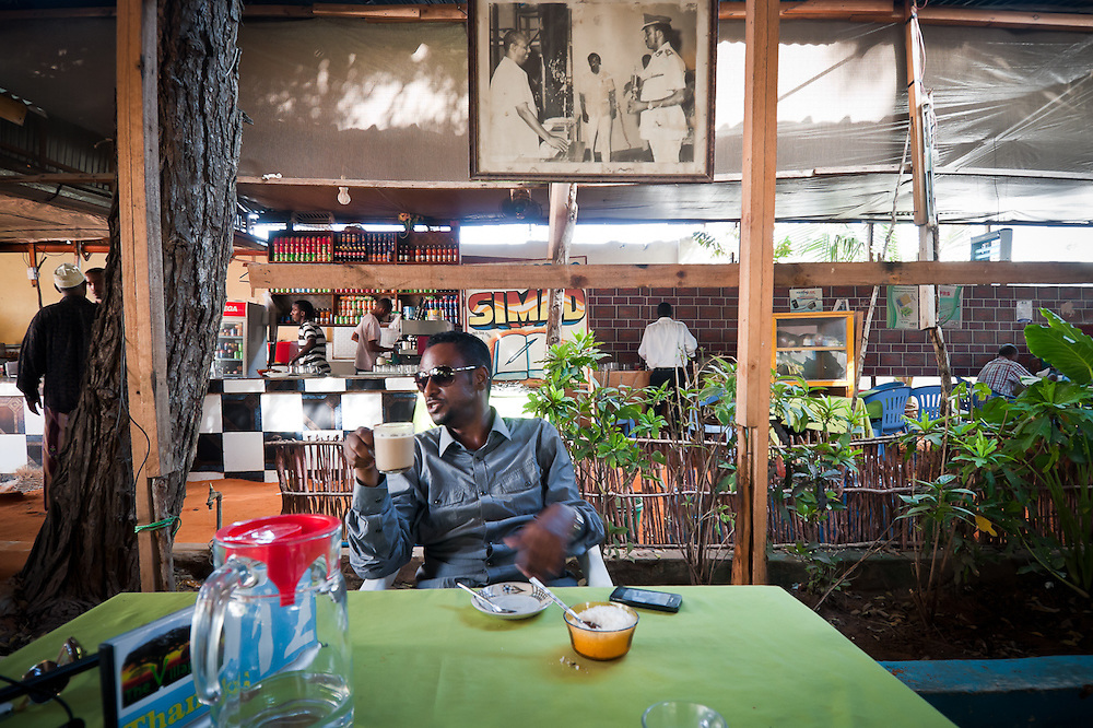 Liban Egal, the American-Somali founder of Somalia Wireless, enjoys an espresso at The Village Restaurant, one of many places in Mogadishu now offering wireless internet to customers.