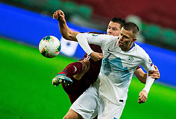 Marcis Oss  of Latvia vs Josip Ilicic  of Slovenia during the 2020 UEFA European Championships group G qualifying match between Slovenia and Latvia at SRC Stozice on November 19, 2019 in Ljubljana, Slovenia. Photo by Vid Ponikvar / Sportida