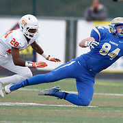 Reed's receiver Parker Houston (84) stretches for a pass while covered by Bishop Gorman's Alex Perry (28) during the NIAA State Championship Football game between the Bishop Gorman Gaels and the Reed Raiders at Damonte Ranch High School in Reno, Nevada.