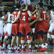 USA Women's National Red and White teams huddle up prior to the start a USA Women's National Team Exhibition game Thursday, Sept. 11, 2014 at The Bob Carpenter Sports Convocation Center in Newark, DEL