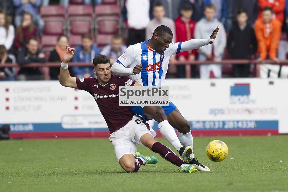 Callum Paterson of Hearts (L) tackles Tope Obdeyi of Kilmarnock (R) during the Ladbrokes Scottish Premiership match between Heart of Midlothian FC and Kilmarnock FC at Tynecastle Stadium on October 4, 2015 in Edinburgh, Scotland. Photo by Jonathan Faulds/SportPix