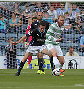 Dundee's Paul McGinn shadows Celtic's Jo Inge Berget - Dundee v Celtic SPFL Premiership at Dens Park<br />