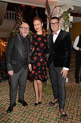 Left to right, DOMENICO DOLCE, OLGA KURYLENKO and STEFANO GABBANA at a party to celebrate the unveiling of the 2014 Claridge's Christmas tree by Dolce & Gabbana at Claridge's, Brook Street, London on 19th November 2014.