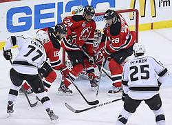 June 9, 2012; Newark, NJ, USA;  New Jersey Devils goalie Martin Brodeur (30) makes a save on Los Angeles Kings center Jeff Carter (77) during the first period of Game 5 of the 2012 Stanley Cup Finals at the Prudential Center.