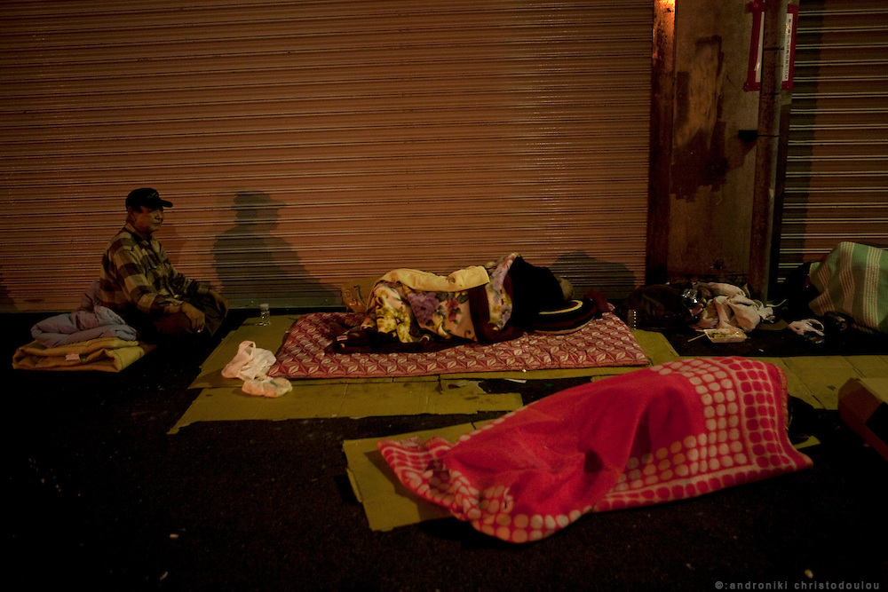 Homeless day laborers sleeping outside Airin Labor Welfare Center in Kamagasaki. They are waiting till 5 am when the shatters open and the employers who look for day laborers come to pick up people.