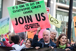 London, UK. 15th April 2019. Climate campaigners from Extinction Rebellion block key thoroughfares around Westminster as part of 'International Rebellion UK - Shut Down London!' events to call on the Government to take urgent action to address climate change.