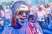 "The Color Run at the Queen Elizabeth Olympic Park - runners of all ages, shapes and sizes take part in a 5k fun run organised by Dulux in aid of Save thae Children. At each kilometre of the course coloured powder covers runners as they pass the  Olympic and Paralympic Games venues, before DJs entertain them  in the Color Festival Area at the finish line. According to the organisers it is – ""Known as the happiest 5k on the planet, The Color Run is an un-timed celebration of health and colour, meaning groups of friends can walk, jog, dance and party their way along the course at any pace."" The colour used at the events is made from food grade cornstarch. It is 100% natural and causes no harm to skin or the environment."