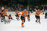 RIT players, led by RIT defenseman Greg Amlong, center, rush the ice after RIT defeated Robert Morris University to win the Atlantic Hockey final at the Blue Cross Arena in Rochester on Saturday, March 19, 2016.