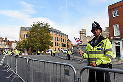 © Licensed to London News Pictures. 12/10/2018. WINDSOR, UK.  A police officer in Windsor ahead of the royal wedding of Princess Eugenie and Jack Brooksbank.  Princess Eugenie, 28, the younger daughter of the queen's third child Prince Andrew and his ex-wife Sarah Ferguson, the Duchess of York, will marry Jack Brooksbank, a 32-year-old drinks executive, in Windsor Castle before taking part in a short carriage procession through Windsor town.  This is the second royal wedding in Windsor in 2018, Prince Harry married Meghan Markle in May.  Photo credit: Stephen Chung/LNP