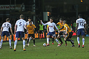 Tottenham Hotspur  Dele Alli (20) surrounded by Newport players during the The FA Cup 4th round match between Newport County and Tottenham Hotspur at Rodney Parade, Newport, Wales on 27 January 2018. Photo by Gary Learmonth.