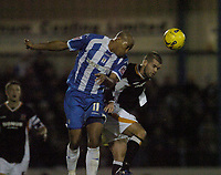 Photo: Olly Greenwood.<br />Colchester United v Hull City. Coca Cola Championship. 28/11/2006. Colchester 's Chris Iwelumo and Hull's John Welsh