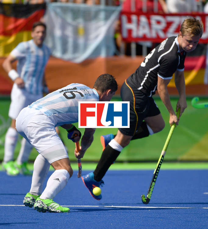 Argentina's Ignacio Ortiz (L) vies with Germany's Mats Grambusch during the men's semifinal field hockey Argentina vs Germany match of the Rio 2016 Olympics Games at the Olympic Hockey Centre in Rio de Janeiro on August 16, 2016. / AFP / Pascal GUYOT        (Photo credit should read PASCAL GUYOT/AFP/Getty Images)