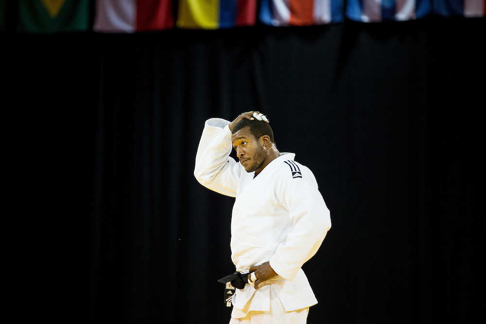 Jose Armenteros of Cuba reacts to his loss to Marc Deschenes of Canada in their men's judo -100kg class final of the table at the 2015 Pan American Games in Toronto, Canada, July 14,  2015.  AFP PHOTO/GEOFF ROBINS