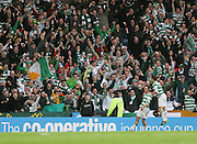 Celtic fans show their joy as Scott McDonald celebrates with goalscorer Aiden McGeady during the League Cup final between Rangers and Celtic at Hampden Park -<br /> David Young Universal News And Sport