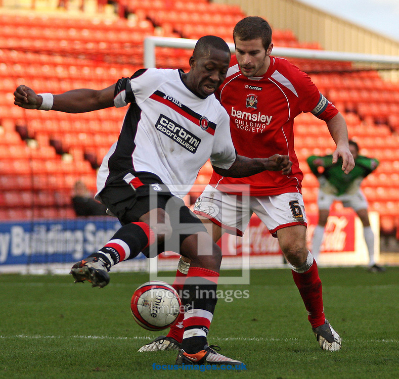 Barnsley - Saturday 21st February 2009 : Chris Dickson of Charlton Athletic & Stephen Foster of Barnsley battle for the ball during the Coca Cola Championship match at Oakwell, Barnsley. (Pic by Steven Price/Focus Images)