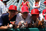 ANAHEIM, CA - APRIL 26:  Young fans of the Los Angeles Angels of Anaheim pose for a photo prior to the game against the Seattle Mariners at Angel Stadium on Sunday, April 26, 2009 in Anaheim, California.  The Angels shut out the Mariners 8-0.  (Photo by Paul Spinelli/MLB Photos via Getty Images)