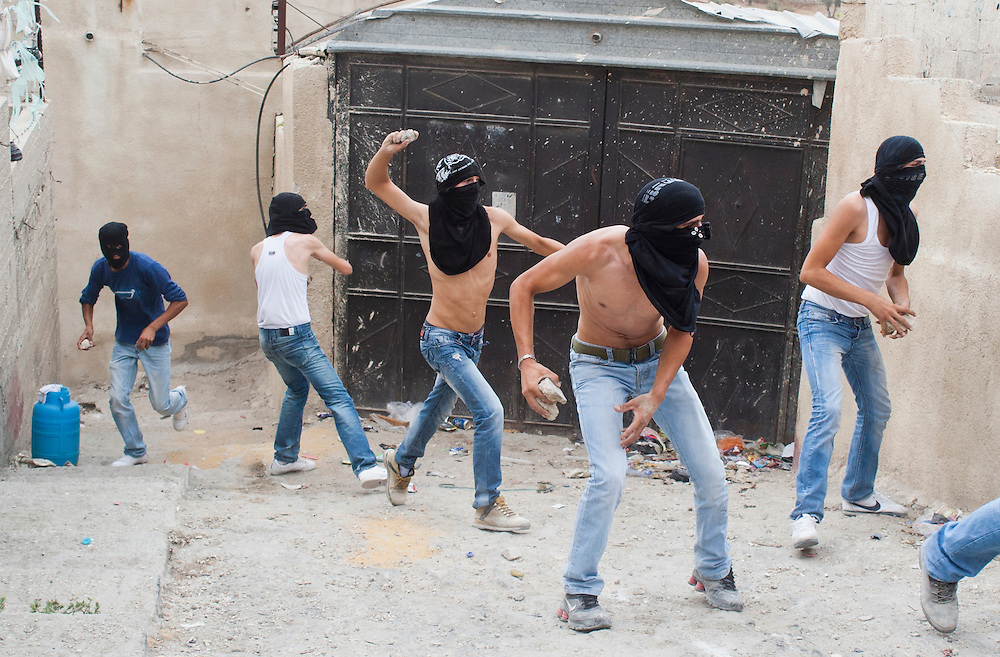 Palestinian stone throwers during clashes with Israeli border police in the East Jerusalem neighbourhood of Silwan September 22, 2010. An Israeli security guard killed a Palestinian on Wednesday in an East Jerusalem district that sees frequent tensions over its Jewish settler enclave, local residents and Israeli police said.   Photo by Oren Nahshon.