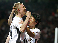 Photo: Lee Earle.<br /> Charlton Athletic v Manchester United. The Barclays Premiership. 23/08/2006. United's Ji-Sung Park (R) congratulates Darren Fletcher after he scored their opening goal.