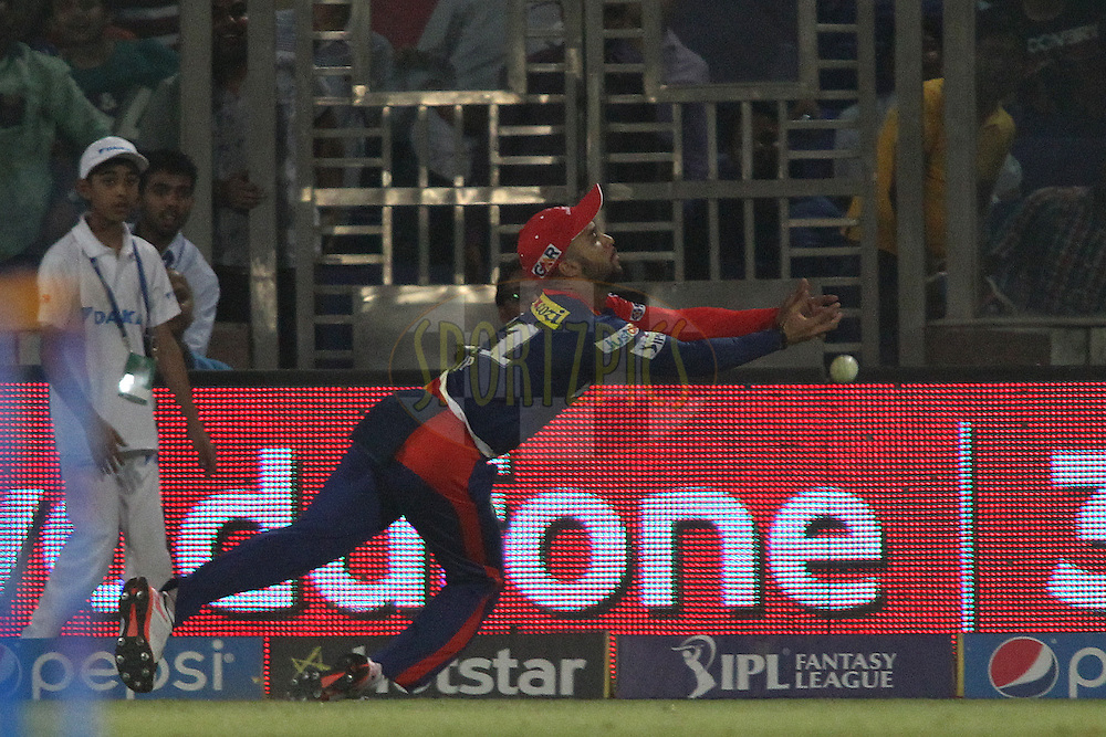Delhi Daredevils captain Jean-Paul Duminy fails to take the catch on the boundary during match 21 of the Pepsi IPL 2015 (Indian Premier League) between The Delhi Daredevils and The Mumbai Indians held at the Ferozeshah Kotla stadium in Delhi, India on the 23rd April 2015.<br /> <br /> Photo by:  Shaun Roy / SPORTZPICS / IPL
