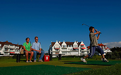 KNOKKE, BELGIUM - AUGUST-2-2005 - Frank and Carine Volders watch their son Jens Volders, 8 tee-off on the mini-golf course in Knokke-Zoute. The Volders live in Antwerp but have a family home in Knokke which they use for holidays. (Photo © Jock Fistick)