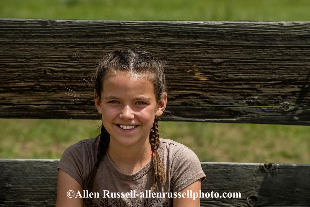 Ryann Ferguson, watching, branding, grandparents, John L. and Debra Moore, Lazy TL Ranch, north of Miles City, Montana