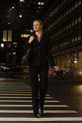 Jul. 25, 2012 - Businesswoman crossing the street (Credit Image: © Image Source/ZUMAPRESS.com)
