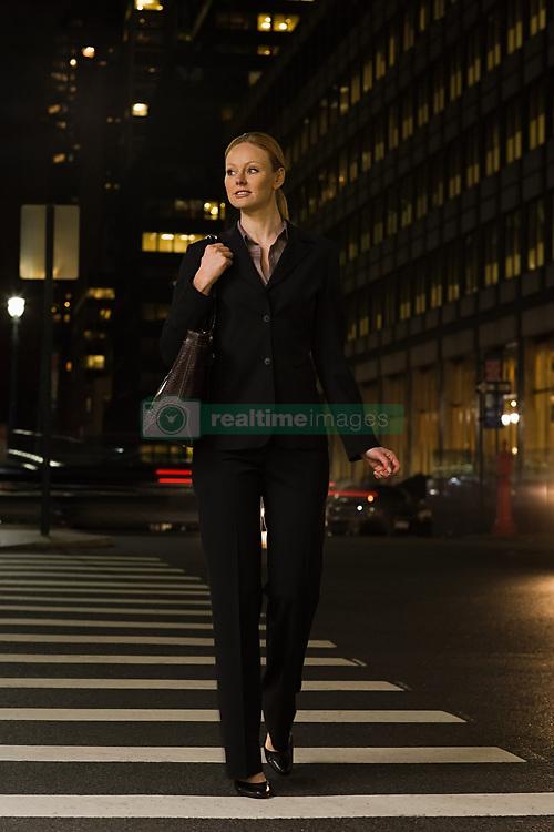 Jul. 25, 2012 - Businesswoman crossing the street (Credit Image: © Image Source/ZUMAPRESS.com)