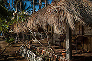 Private thatched roof cabaña at Flower Island Resort.  Shark Fin Bay.  Tay Tay, Palawan, Philippines.