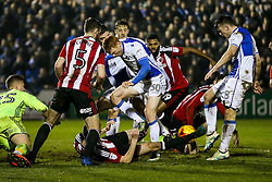 Lee Brown and Ollie Clarke of Bristol Rovers scramble to get a shot away - Rogan Thomson/JMP - 14/02/2017 - FOOTBALL - Memorial Stadium - Bristol, England - Bristol Rovers v Sheffield United - Sky Bet League One.