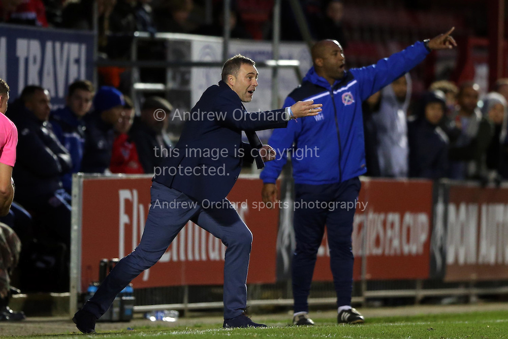 Wayne Burnett, the Dagenham &amp; Redbridge manager shouting at his players from the touchline. The Emirates FA Cup, 2nd round match, Dagenham &amp; Redbridge v Whitehawk FC at the The London Borough of Barking &amp; Dagenham Stadium in London on Sunday 6th December 2015.<br /> pic by John Patrick Fletcher, Andrew Orchard sports photography.