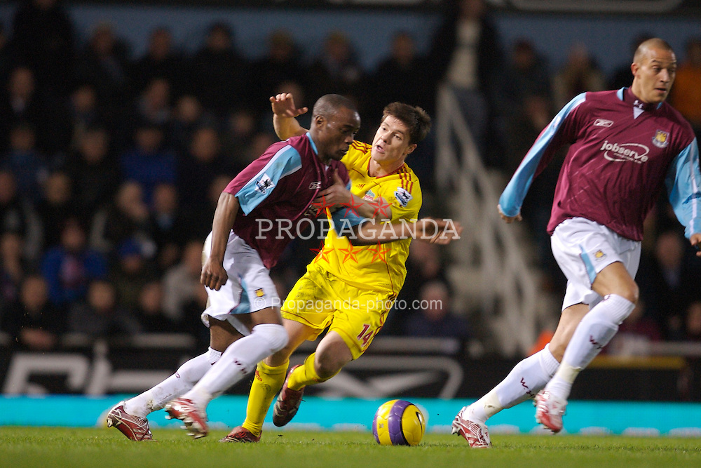 London, England - Tuesday, January 30, 2007: Liverpool's Xabi Alonso and West Ham United's Nigel Reo-Coker during the Premiership match at Upton Park. (Pic by David Rawcliffe/Propaganda)