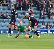 27th August 2017, Dens Park, Dundee, Dundee; Scottish Premier League football, Dundee versus Hibernian; Dundee's James Vincent tackles Hibernian's John McGinn
