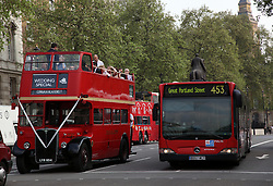 21 April 2010. London, England..London busses, old and new along Whitehall, part of the Royal wedding route where the procession will pass through en route to Buckingham Palace in the run up to Catherine Middleton's marriage to Prince William..Photo; Charlie Varley.