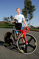 21 January 2007:  Women's cyclist Sarah Hammer (USA) at the UCI Track Cycling World Cup Classics @ the Home Depot Center, Carson CA.  Outdoor portrait with bike. Team OUCH OPC pro cycling gear.