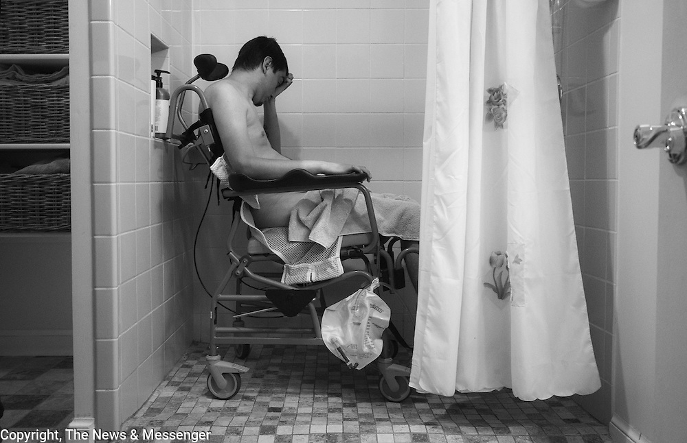 Ricky Chang showers on Monday October 25, 2010.  Showers for a Ricky are a complicated affair made easier by a specialized chair and shower stall with a ramp for access. For the News & Messenger (Manassas, VA)