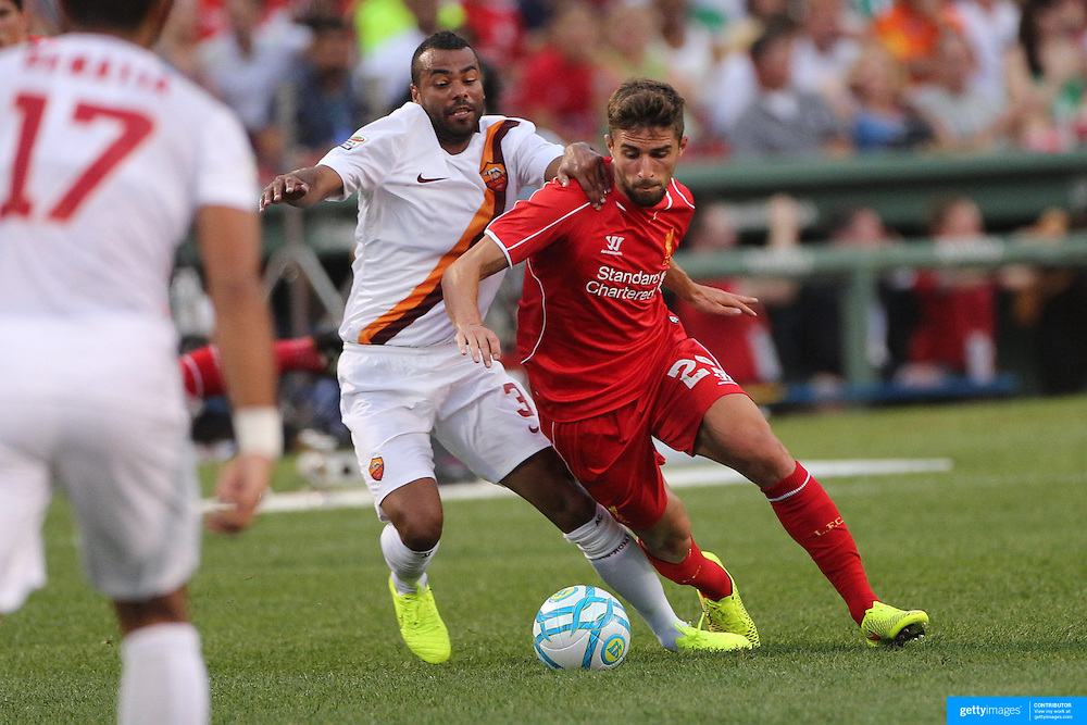 Fabio Borini, (right), Liverpool, is challenged by Ashley Cole, AS Roma, during the Liverpool Vs AS Roma friendly pre season football match at Fenway Park, Boston. USA. 23rd July 2014. Photo Tim Clayton