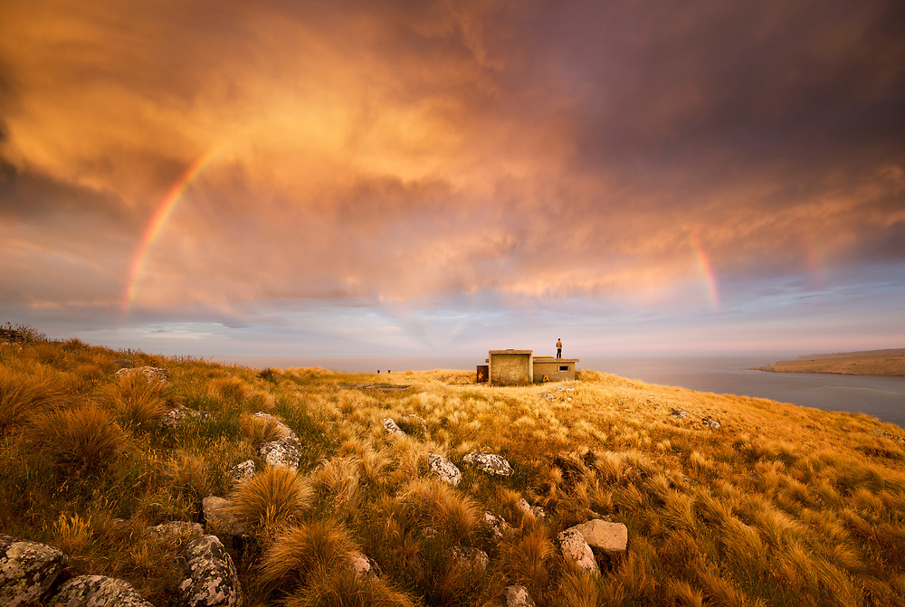 A full rainbow at sunset over a WW2 Gun Emplacement at Godley Head, Christchurch, New Zealand