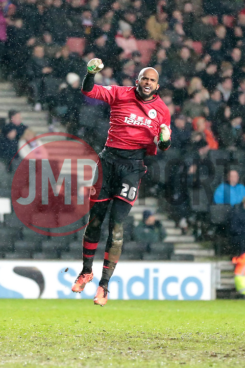Wigan Athletic's Ali Al-Habsi celebrates Wigans second goal - Photo mandatory by-line: Nigel Pitts-Drake/JMP - Tel: Mobile: 07966 386802 14/01/2014 - SPORT - FOOTBALL - Stadium MK - Milton Keynes - MK Dons v Wigan Athletic - FA Cup - Third Round replay